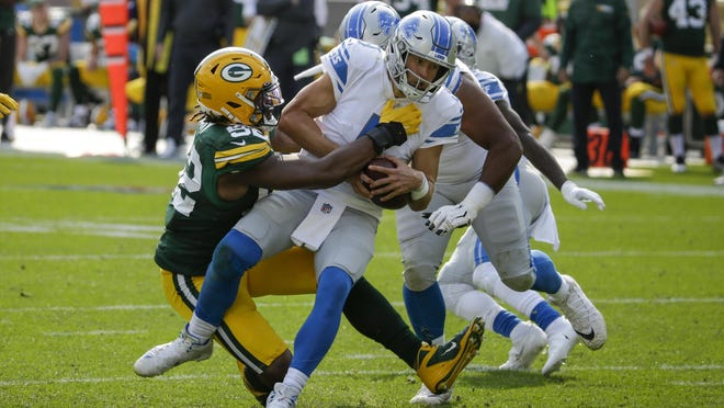 Green Bay Packers' Rashan Gary sacks Detroit Lions quarterback Matthew Stafford during the second half of an NFL football game Sunday, Sept. 20, 2020, in Green Bay, Wis.