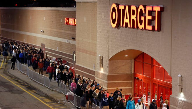 Shoppers head into Target just after the doors opened at midnight on Black Friday, Nov. 28, 2014, in South Portland, Maine.