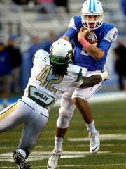 MTSU's quaterback Austin Grammer gets taken down by UAB's Shaq Jones during the 4rd quarter of the game Homecoming game on Saturday, October 18, 2014.