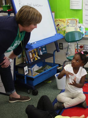 A Montclair Elementary Pre-K teacher works with a student during the 2014-15 school year.
