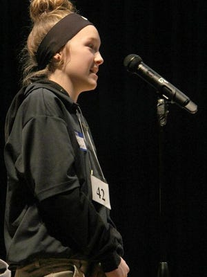 Liberty Middle School eighth grader Bailey Jackson concentrates as she spells the winning word to win the Pratt County Spelling Bee on Tuesday morning at LMS. Jackson out spelled 49 other contestants to win the bee and become eligible to compete in the Sunflower State Spelling Bee at Newman College in Wichita on March 21.
