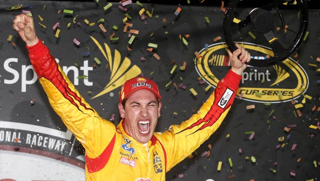 Joey Logano celebrates in victory lane after winning his second race of the season -- at Richmond International Raceway.