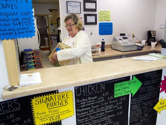 "Marlene McDade, who works at The Pickle Nickel in Dillsburg, doesn't want the liquor referendum to pass. ""I've seen a lot of small towns just fall apart,"" she said."