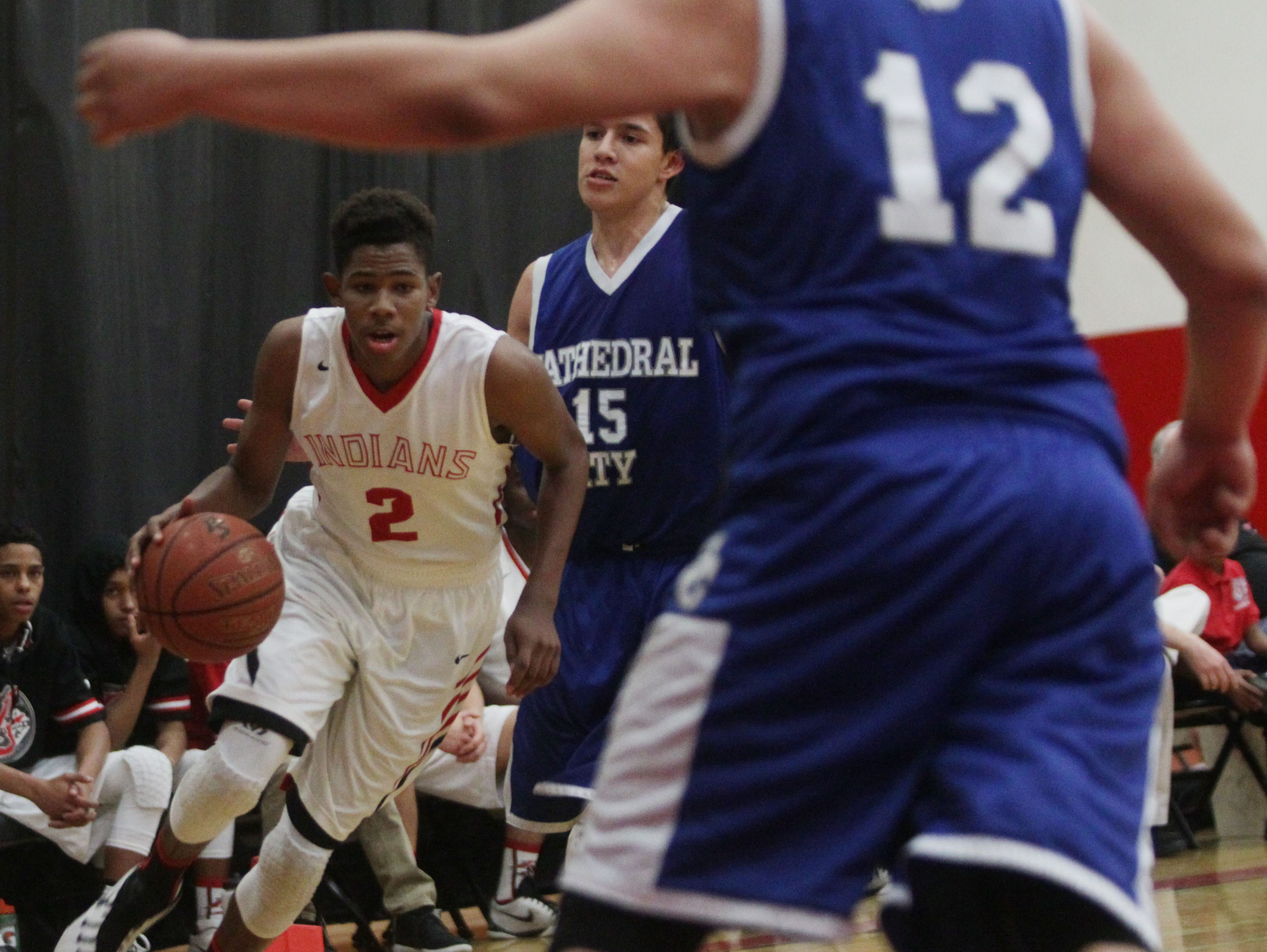 John Rich, of Palm Springs High School, drives to the basket during their home game against Cathedral City. Palm Springs won the game 80-43 and claimed the DVL title.