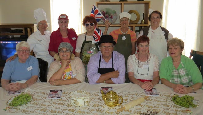 """The Great British Bump Off"": Back row (left to right): Marianne Johnstone, Barb King, Valerie Thompson, Connie Barrett and Caroline Pope. Front row (left to right): Ruth Cox, Lorna Hardy, Clark Hardy, Kathie Chatlin and Lorraine Bellaro."