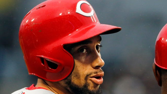 Cincinnati Reds' Billy Hamilton smiles after stealing third during a baseball game against the Pittsburgh Pirates in Pittsburgh, Saturday, Sept. 2, 2017. (AP Photo/Gene J. Puskar)