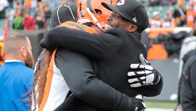 Former Cincinnati Bengals wide receiver Chad Johnson is hugged by Cincinnati Bengals defensive tackle Domata Peko (94) before the Week 13 game between the Cincinnati Bengals and the Philadelphia Eagles, Sunday, Dec. 4, 2016, at Paul Brown Stadium in Cincinnati.