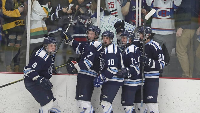 Green Bay Notre Dame's student section watches as Bay Port players Austin Mikesch, Will Kendall, Matej Huncik, Spencer Challe and Sam Gustafson celebrate a goal in the Pirates' 4-2 sectional semifinal win Feb. 21 at the Cornestone Community Center in Ashwaubenon.