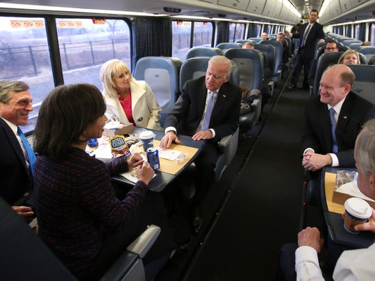 Vice President Joe Biden (center) holds court with the Delaware delegation including (from left) Governor John Carney, Rep. Lisa Blunt Rochester, his wife, Dr. Jill Biden, and Senators Chris Coons and Tom Carper on an Amtrak Acela train bound for Wilmington after attending inauguration events Friday.