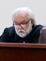 Judge John Dean announces a 'not guilty' verdict in the trial of former Farmington Police officer Ricard Emmert on Friday at the 11th Judicial District Court in Aztec.