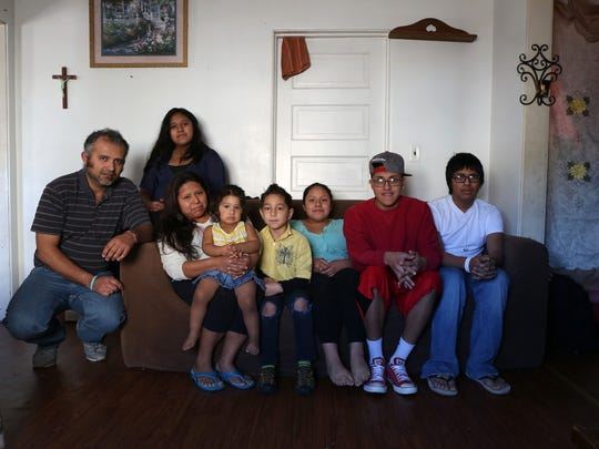Cesar Chavez, left, lives with his wife and six children, ages 2 to 17, in Marshalltown. He estimates he is owed $4,000 for taping work he did at a West Des Moines apartment complex.