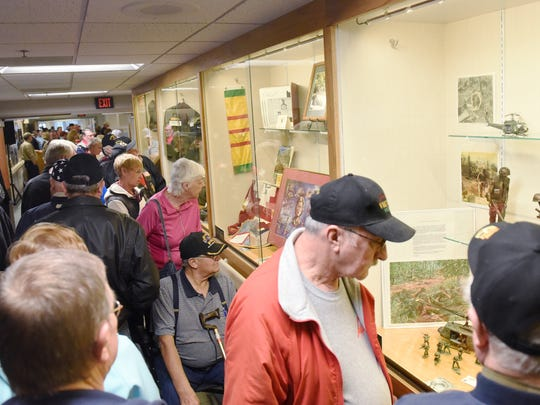 Visitors check out a display of Vietnam memorabilia Tuesday during a national Vietnam veteran recognition day open house at the VA Hospital in Sioux Falls, March 29, 2016. The display is open to the public and will be up until the end of April.