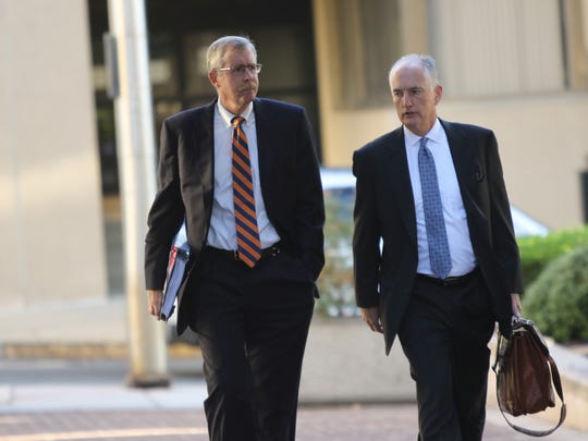 William B. North, left, former Wilmington Trust chief credit officer, arrives at J. Caleb Boggs Federal Building in October 2017.