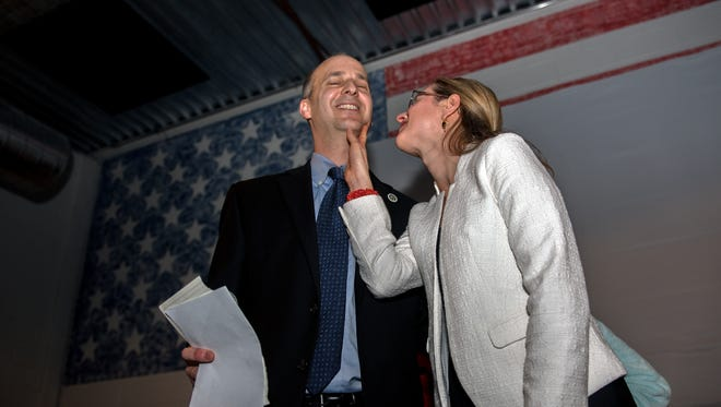 Andy Schor celebrates alongside his wife, Erin, on Tuesday, November 7, 2017 after being elected Lansing's mayor.