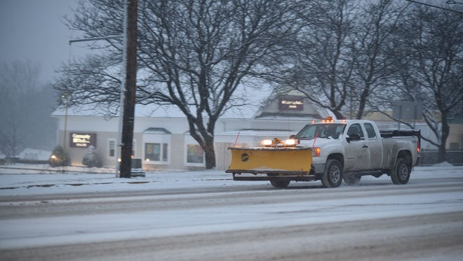 A snowplow heads south on Shelburne Road in South Burlington Tuesday morning, Dec. 12, 2017, as the first significant snowfall of the season hit the region.