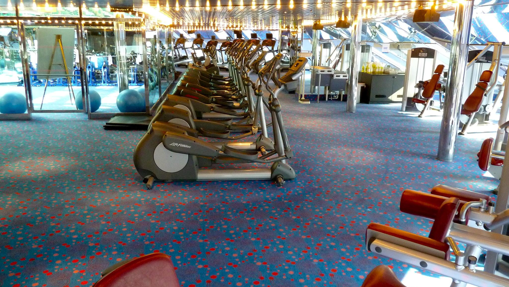 Equipped with an assortment of the latest cardio and weight machines, as well as free weights, the gym overlooks the bow from the forward portion of Deck 11.