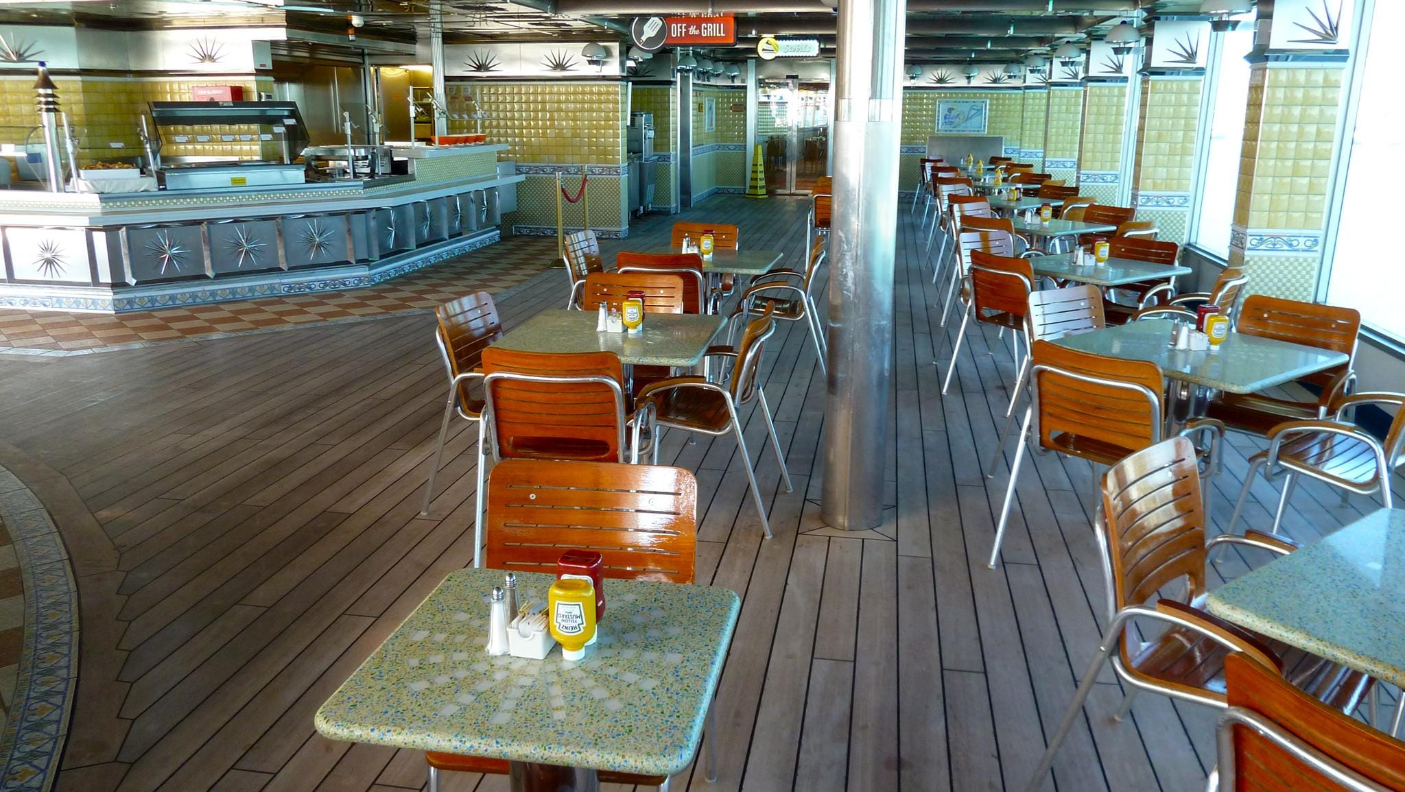 This is the forward/port portion of Rosie's on Deck 10, offering al fresco seating near the Argonaut Pool.