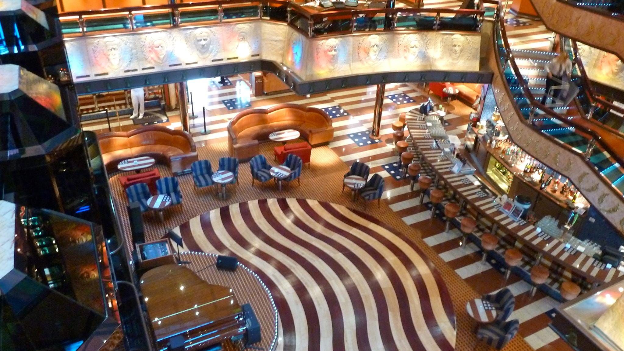 "The Atrium America has more than a subtle hint of built-in Americana with its red, white and blue-tiled decking and ""stars and stripes"" bar counter and seating."