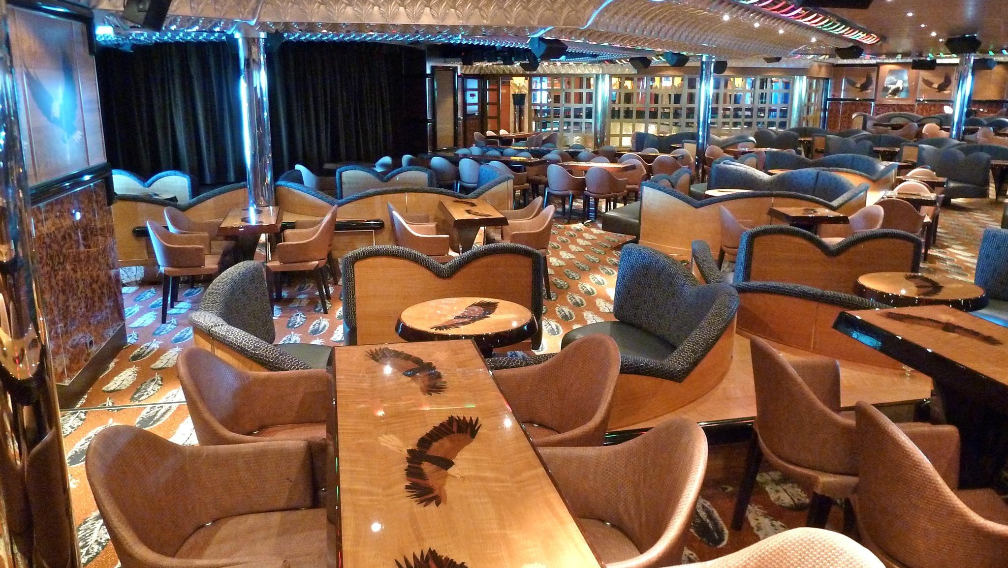 The aft show lounge and comedy club Eagles seats 425. Marquetry-topped tables feature eagles in flight and realistic looking eagles inhabit various vitrines throughout the room.