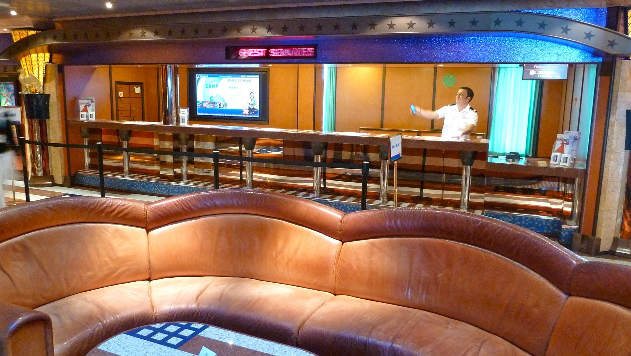 Guest Services is on the starboard side of the Deck 3 level of the Atrium America.
