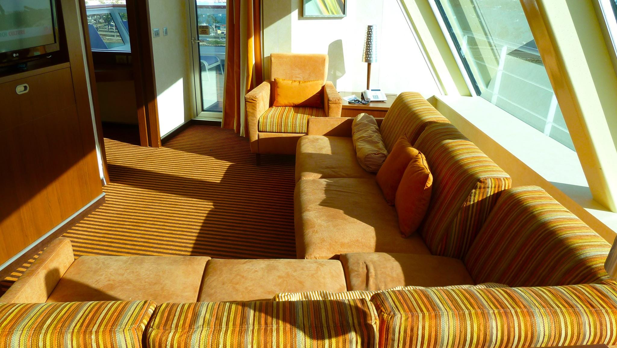 Carnival Valor has two Captain's Suites directly above the wheelhouse on Deck 9. They have sitting areas fronted with picture windows.