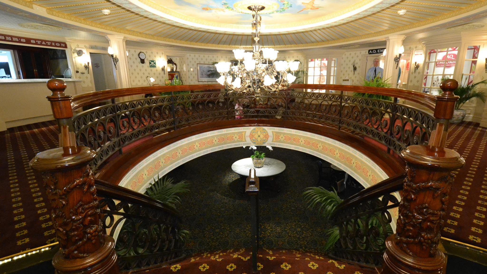 The view from the Purser's Lobby looking down the grand staircase to the Lounge.