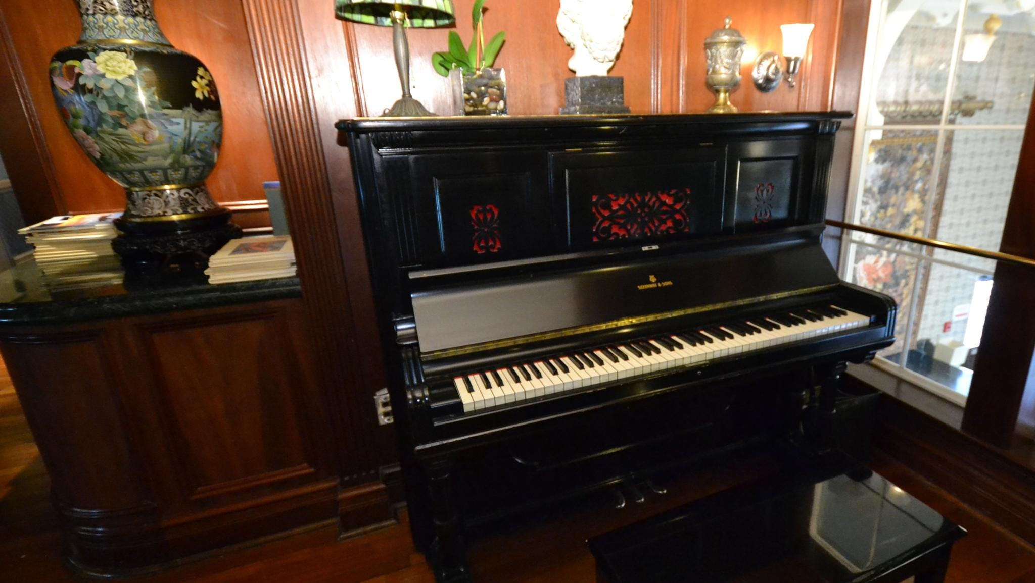 Passengers in the Mark Twain Gallery often are treated to live piano music played on this upright piano.