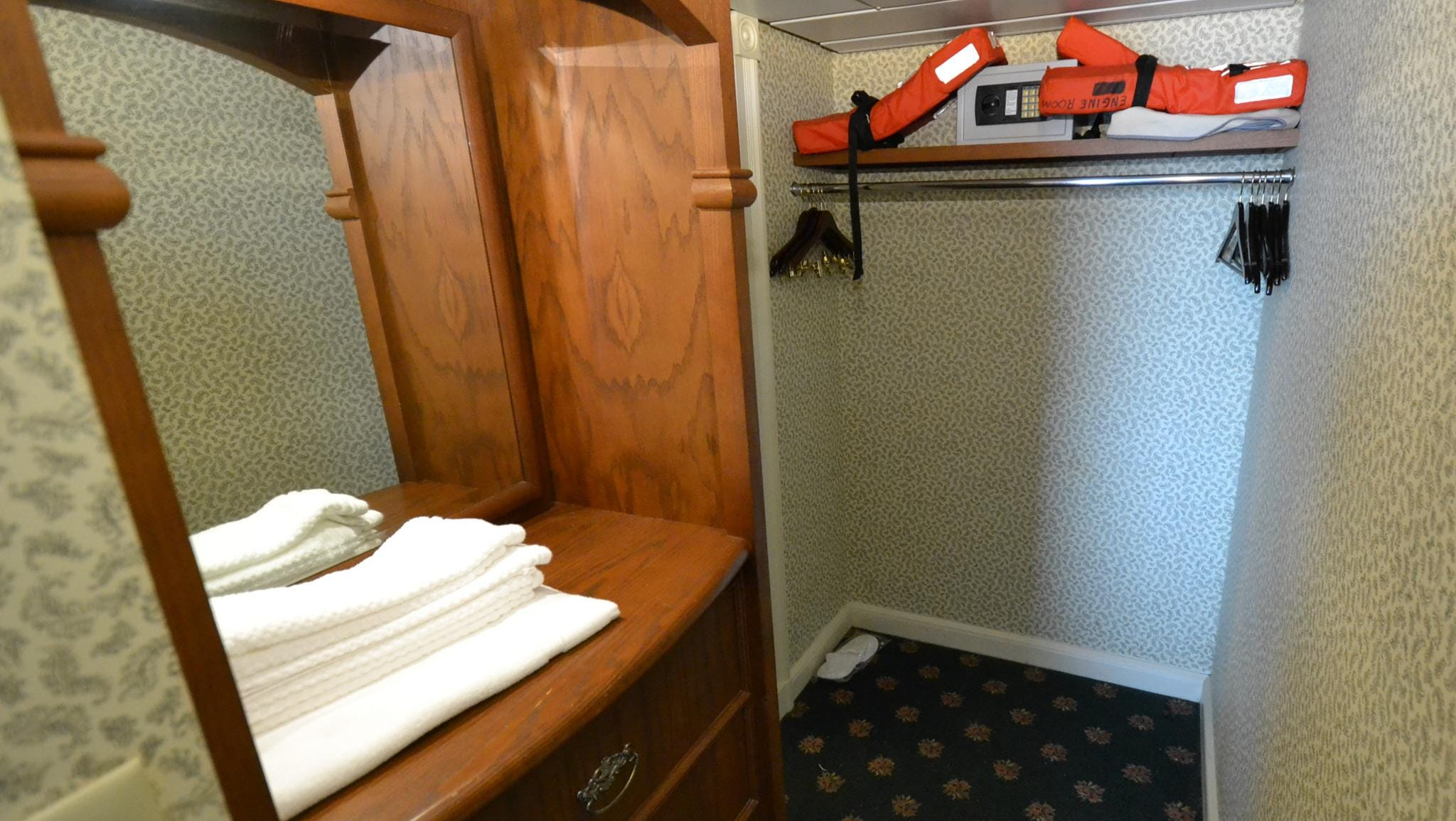 The closet area of the Tennessee room is typical of what is found in the Deluxe Outside Stateroom with Veranda category of cabins