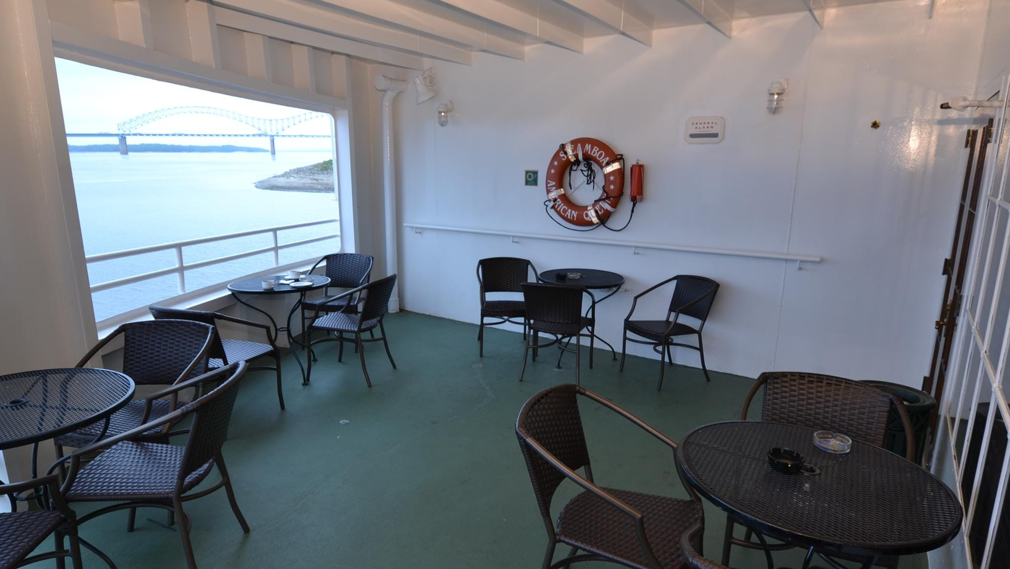 The Engine Room Bar also offers two outdoor seating areas with views of the American Queen's paddle wheel.