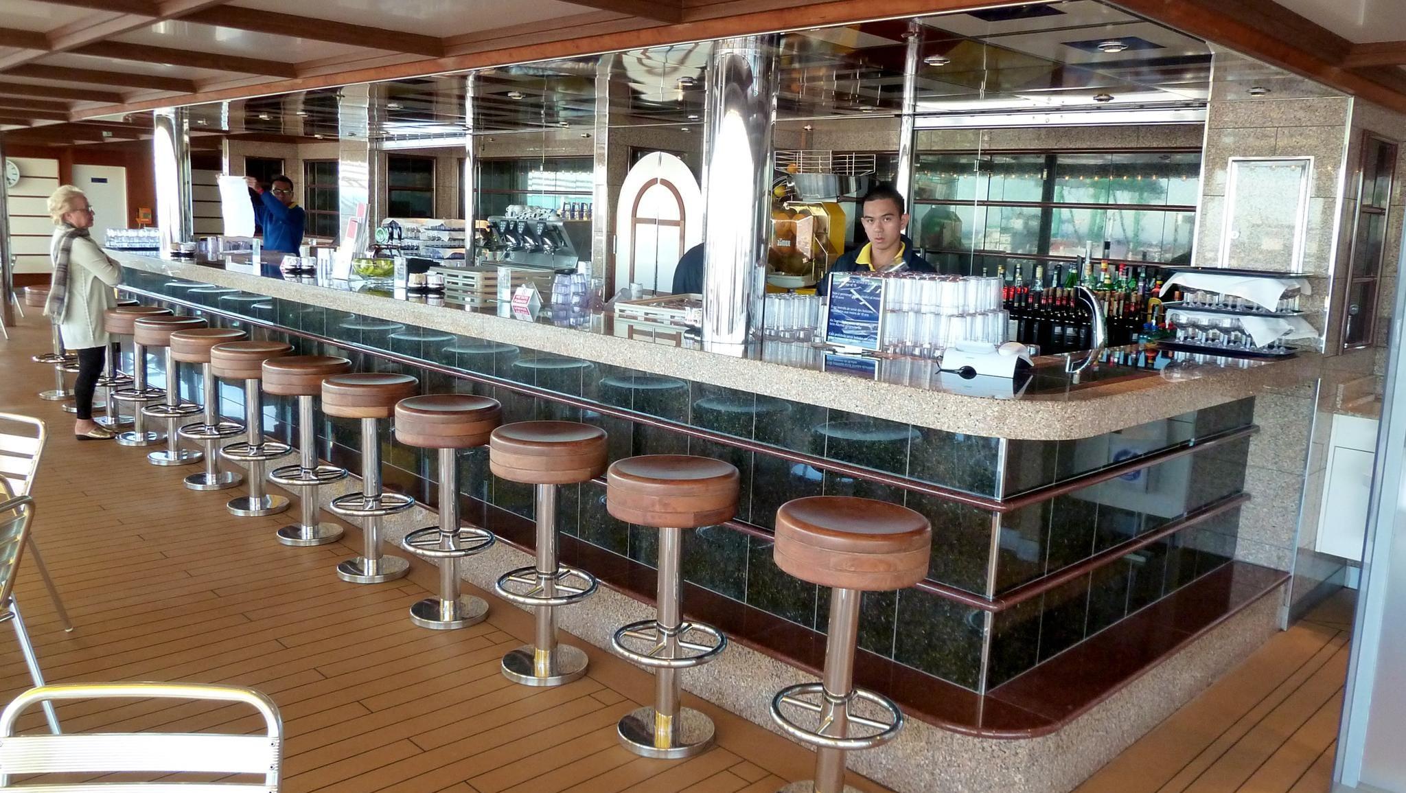 The al fresco Orchidea Bar overlooks the open lido space on aft Orchidea Deck.