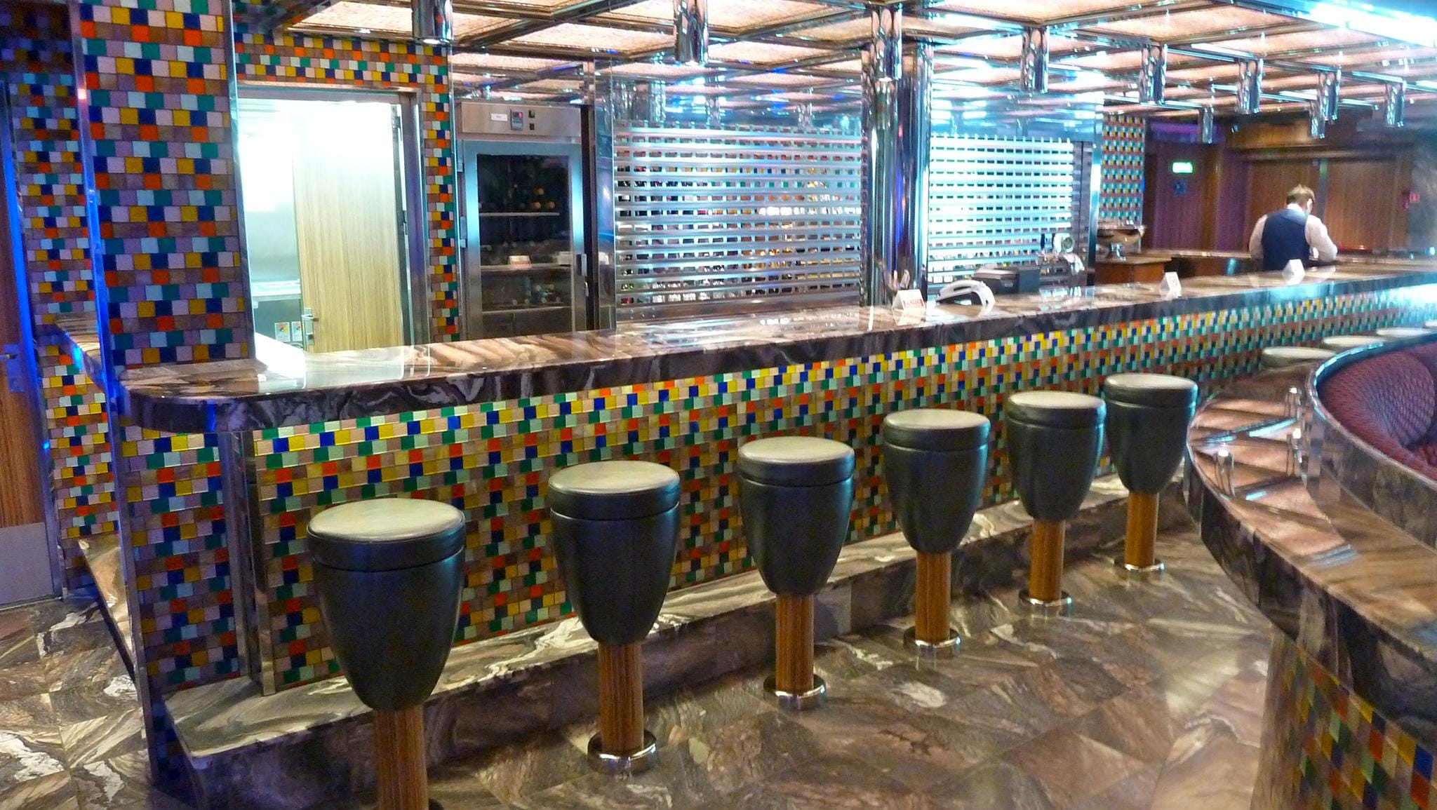 The Piano Bar, itself, is festooned with multi-colored glass tiles.