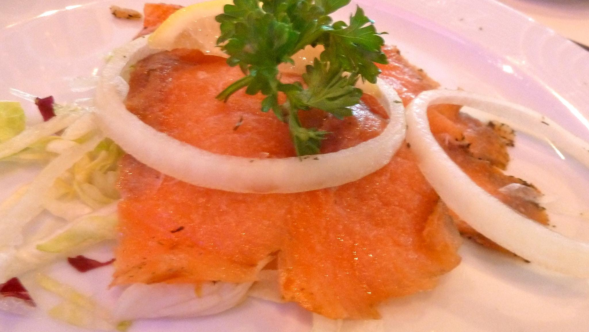 Lunch and dinner menus come with a selection of appetizers, such as lemon-drenched smoked salmon with slivered onions.