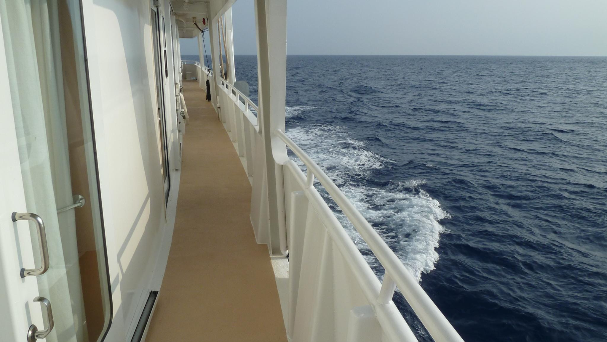 Cabin Deck accommodation is accessed via doors that open onto narrow promenades on either side.