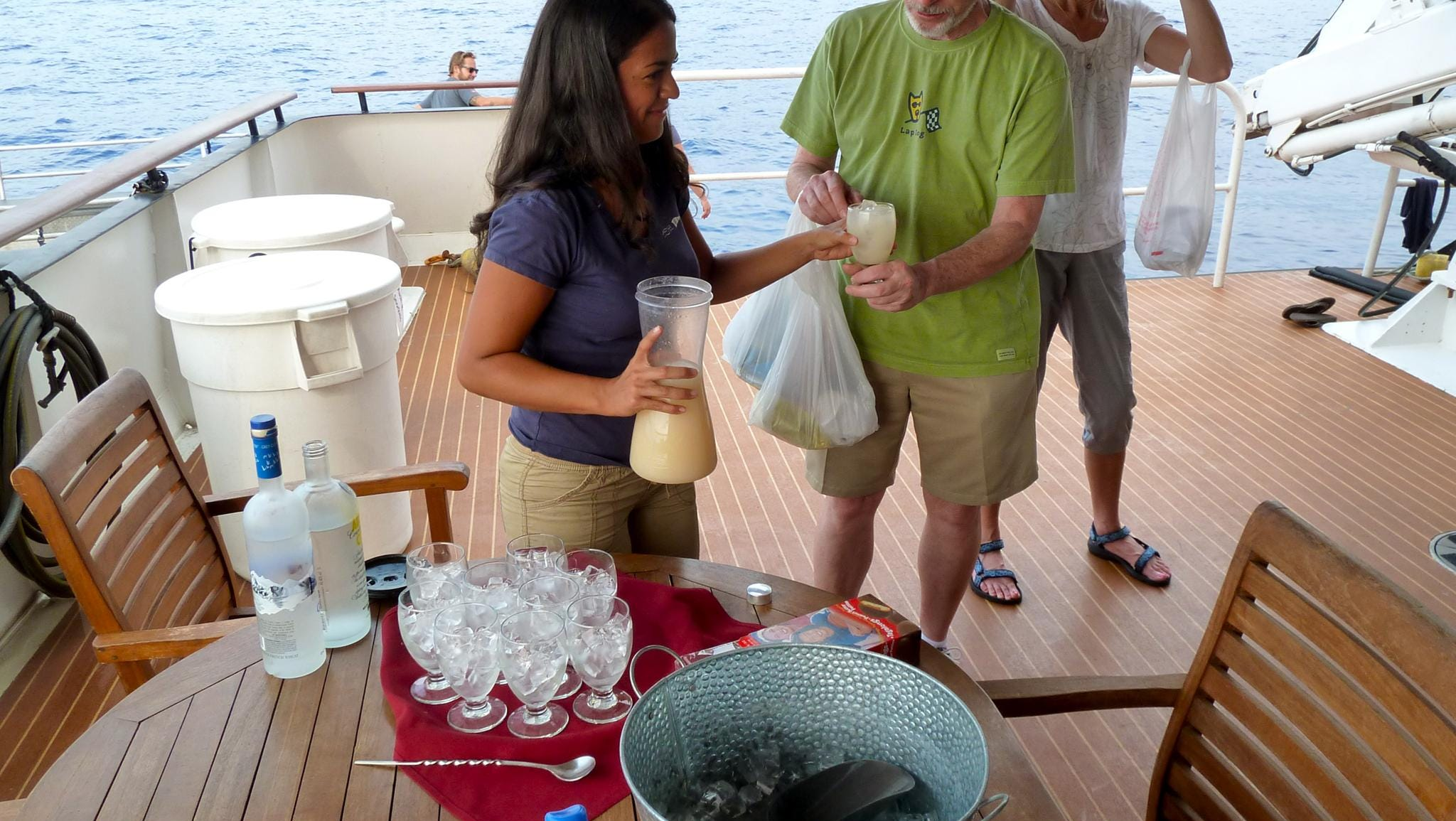 After exhilarating snorkel and zodiac rides, or long shore tours, a friendly crewmember greets returning guests with a refreshing drink.