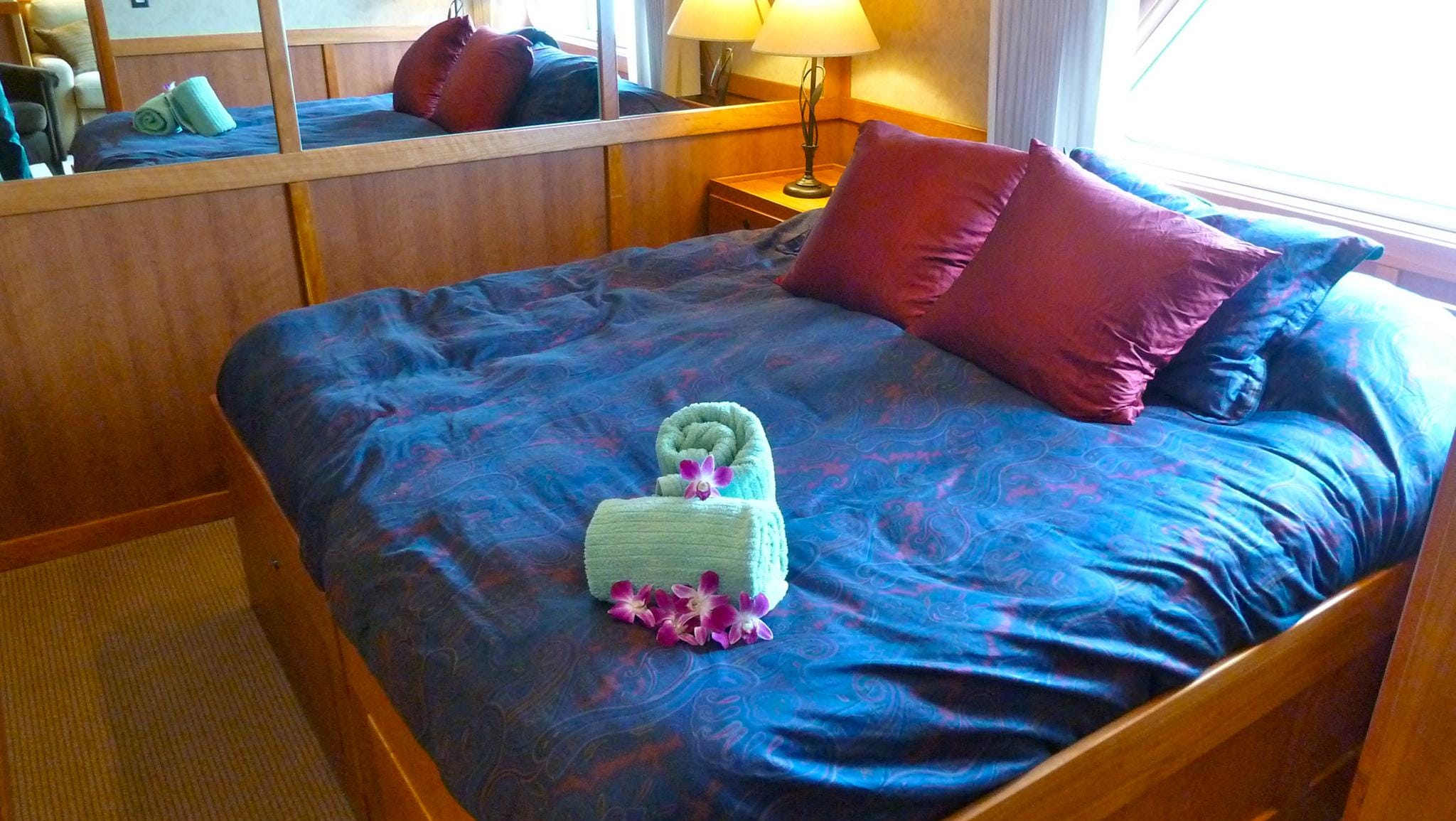 Commodore Suites have a bedroom with king-sized bed, a flat-screen television, extra storage and a picture window.