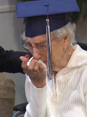 Margaret Bekema, 97, of Walker, Mich., is overcome with emotion as she receives her high school diploma Oct. 29, 2015.