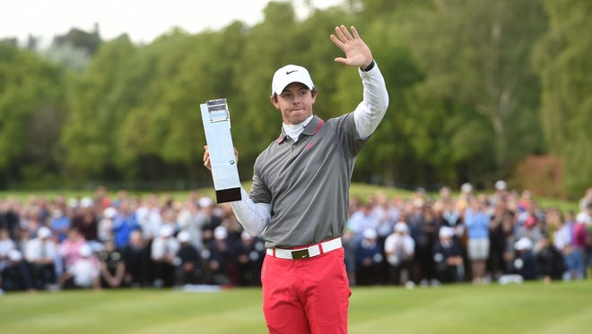 Northern Ireland's Rory McIlroy with the trophy after he won the BMW PGA Championship on Sunday.
