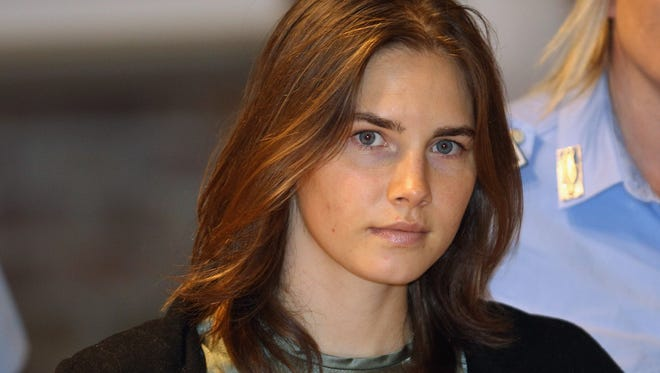 Amanda Knox is escorted to her appeal hearing at Perugia's Court of Appeal on September 29, 2011, in Perugia, Italy.