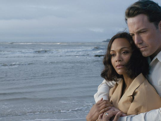 "Ben Affleck and Zoe Saldana star in ""Live By Night."""