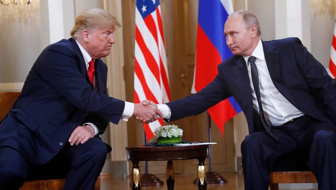 U.S. President Donald Trump, left, and Russian President Vladimir Putin meet at the Presidential Palace in Helsinki, Finland, Monday, July 16, 2018.