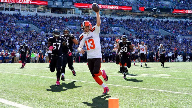 Oct 11, 2015: Cleveland Browns quarterback Josh McCown (13) celebrates as he run in for a touchdown during the third quarter against the Baltimore Ravens at M&T Bank Stadium.