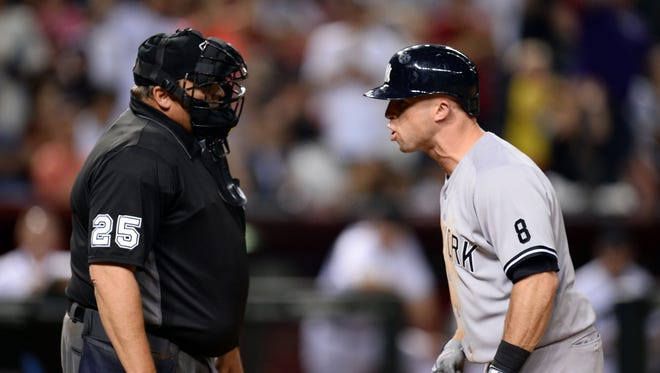 May 17, 2016: New York Yankees left fielder Brett Gardner (11) argues with umpire Fieldin Culbreth (25) after being called out on strikes during the eighth inning against the Arizona Diamondbacks at Chase Field.
