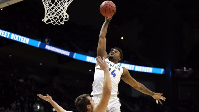 Nevada's Jordan Caroline drives to the basket against Loyola center Cameron Krutwig during their game Thursday in Atlanta.