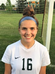 Novi's Jessie Bandyk is all smiles after scoring her