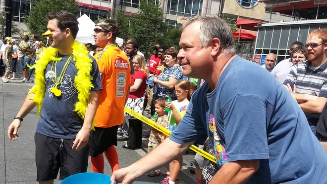 Freestore Foodbank volunteer Derek Fry takes part in the 2014 Quacky Race on Fountain Square in downtown Cincinnati. The event launches awareness of the Rubber Duck Regatta, which benefits the agency. Fry has been a Freestore Foodbank volunteer since 2002.