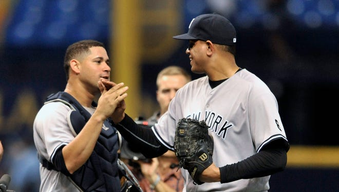 New York Yankees catcher Gary Sanchez, left, and closer Dellin Betances celebrate a 5-3 win over the Tampa Bay Rays during a baseball game Tuesday, Sept. 20, 2016, in St. Petersburg, Fla.