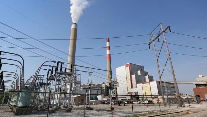 Water vapor rises from a stack at Indianapolis Power & Light Co.'s Harding Street Station, which is being converted from a coal-burning plant to one that uses natural gas to heat water into steam to drive turbine generators that produce electricity. Two of the three active generating units are converting to natural gas, with the third under review.