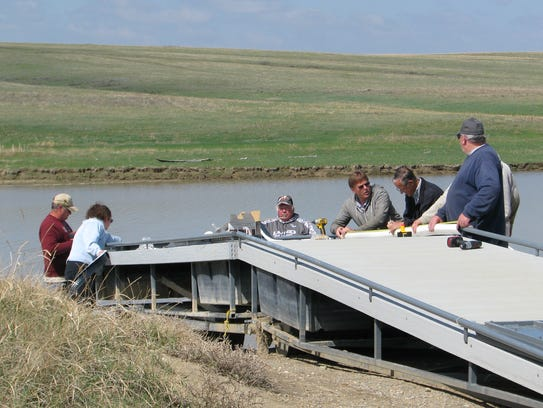Local sportsmen and Walleyes Unlimited volunteers installed