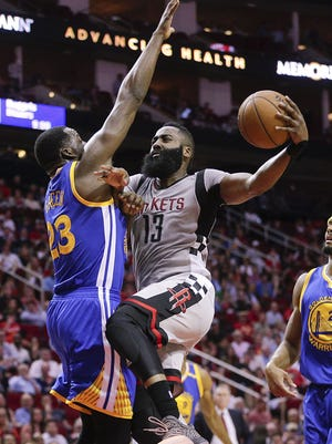 Houston Rockets guard James Harden (13) drives to the basket against Golden State Warriors forward Draymond Green (23) in the first quarter at Toyota Center.