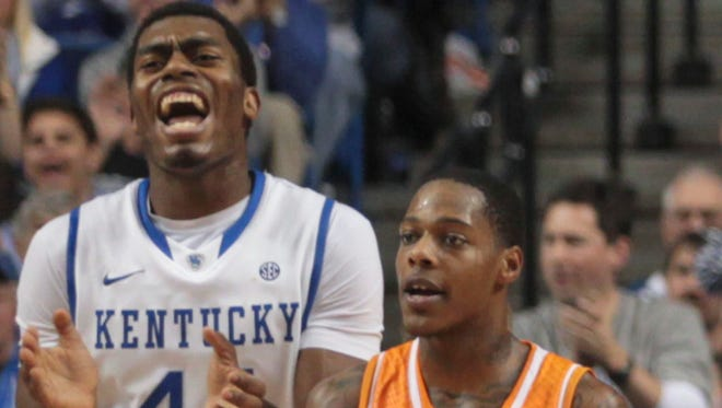 Kentucky's Dakari Johnson laughs as Tennesse's Antonio Baron complains Saturday afternoon at Rupp Arena in Lexington. The Wildcats beat the Volunteers 74-66.